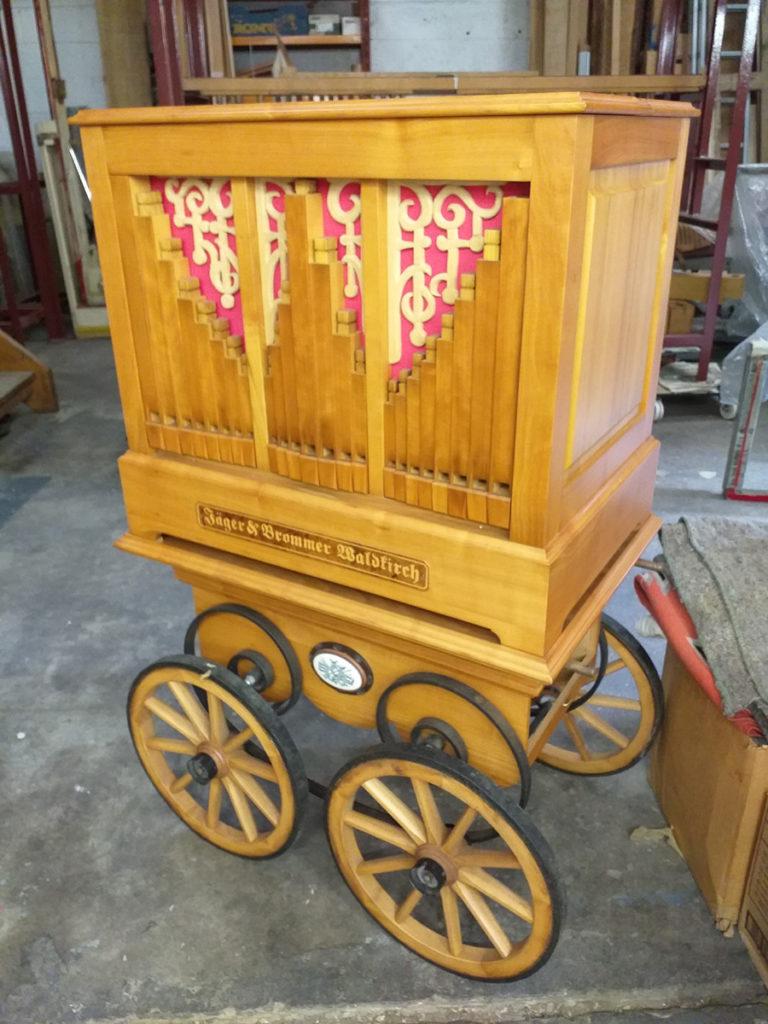 Jäger & Brommer 31-note street organ on cart